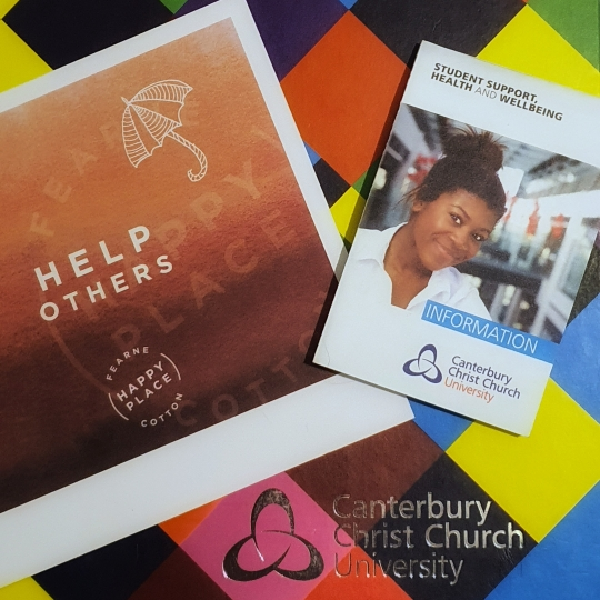 """2019-2020 Canterbury Christ Church University diary with Student Support, Health and Wellbeing fold-out, and Fearne Cotton's Happy Place Reflection Card which reads """"Help Others"""""""